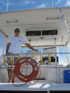 Click to enlarge image CAPT TOMMY ON FLYING BRIDGE - The Fly Bridge of the Blue Runner 2 -
